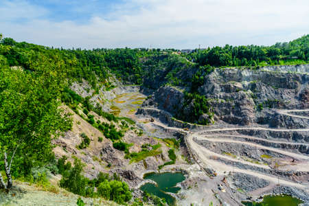 View on cliffs in a granite quarry Stock fotó