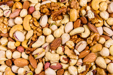 Background of various nuts (almond, cashew, hazelnut, pistachio, walnut). Vegetarian meal. Healthy eating concept