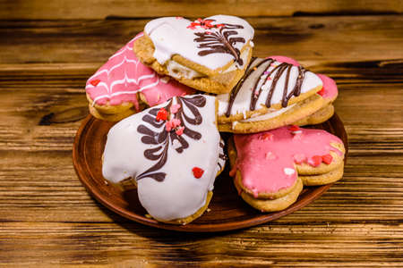 Cookies made in shape of heart on wooden background Stock fotó