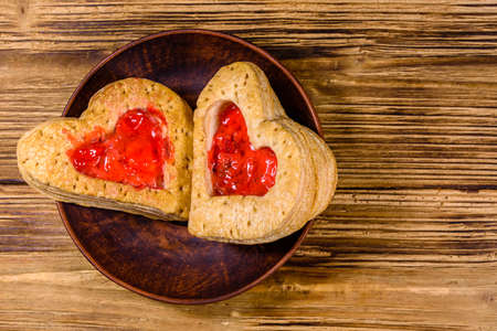 Pastry made in shape of heart on wooden background Stock fotó