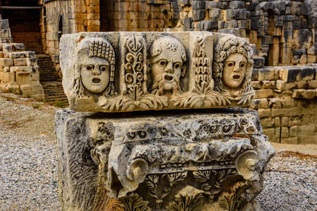 Stone faces bas relief at Myra ancient city. Demre, Turkey