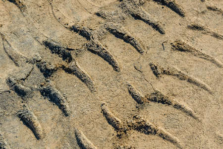 Impints of truck tires on sand near quarry. Earthworks, offroad