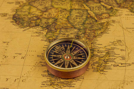 Compass on old map of world. Journey and discovery concept Stockfoto