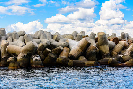 Breakwater made of tetrapods in sea. Coastal defence barrier