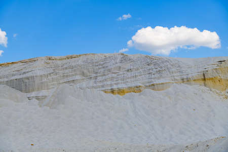 Pile of white sand at abandoned quarry