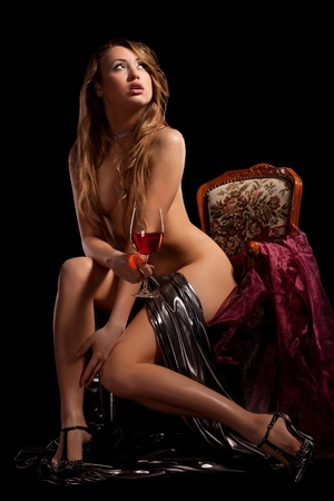 Sexy woman sitting on the chair Stock Photo - 8938416