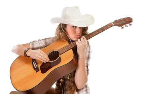 guitarra sexy: SESY vaquera en sombrero de vaquero con guitarra ac�stica Foto de archivo