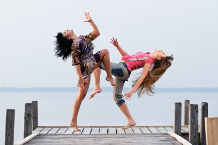 two girls are dancing photo