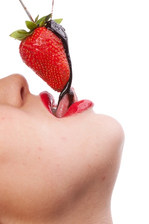 girl eating strawberry with chocolate sauc photo