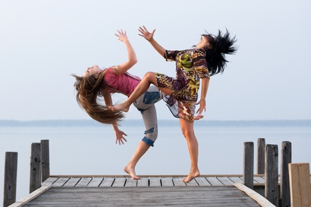two girl  are dancing photo