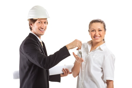 smiling engineer giving keys from apartment photo