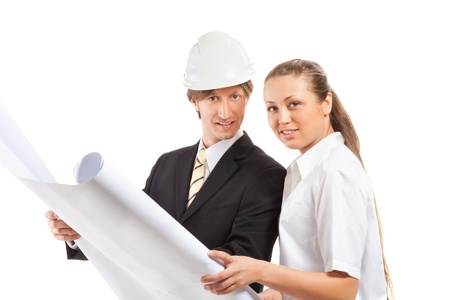 An architect wearing a hard hat and co-worker photo