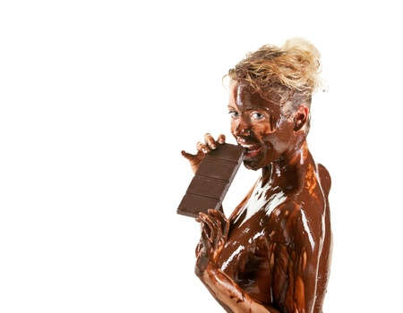 naked blond girl eating chocolate