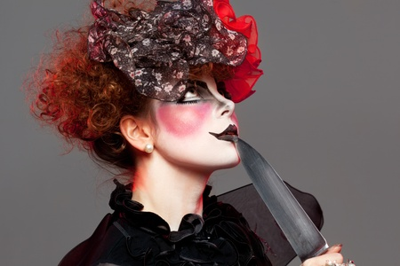 woman mime with knife photo