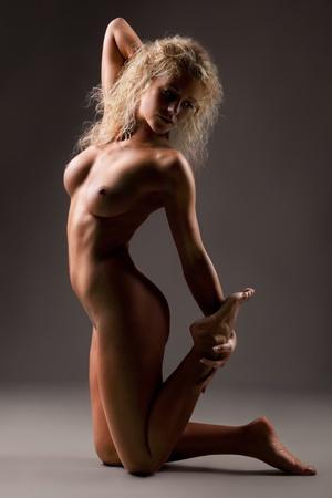 naked women on grey background Stock Photo