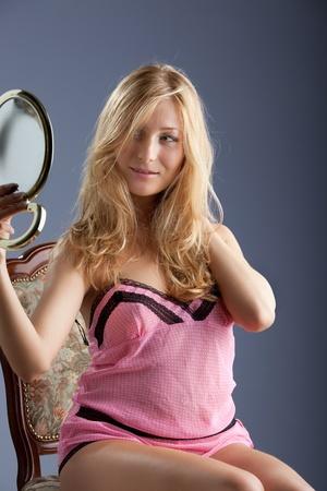 beautiful woman with mirror photo