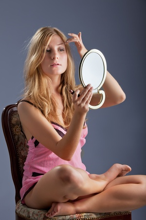 beautiful woman with mirror photo
