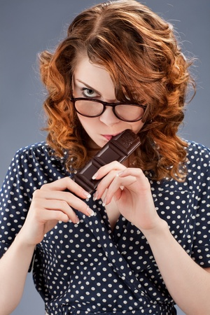 happy smiling woman eating chocolate photo