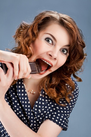 happy smiling woman eating chocolate Stock Photo - 9337805
