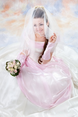 Beautiful woman dressed as a bride photo
