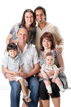 Studio Shot Of Family Group Sitting In Studio photo