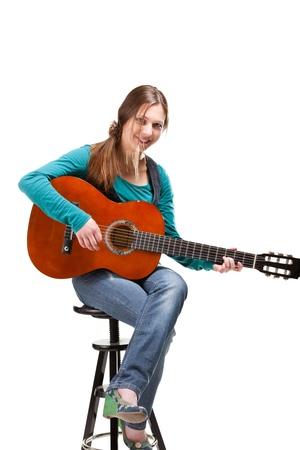 guitarra sexy: vaquera en ahat con guitarra ac�stica