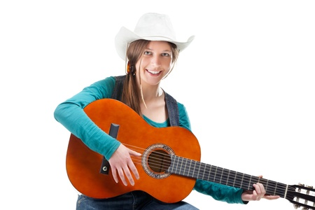 cowgirl in ahat with acoustic guitar Stock Photo - 10238156