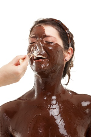 chocolate mask: young woman having a chocolate face mask