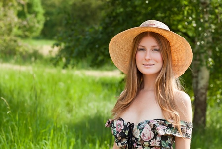 red haired woman: Young beautiful girl with hat posing outdoor Stock Photo