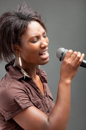 kareoke: Black Woman Singing Into Microphone  Stock Photo