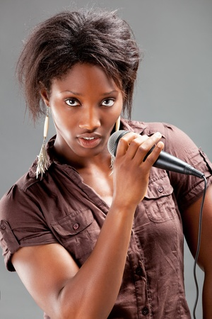 Black Woman Singing Into Microphone  photo