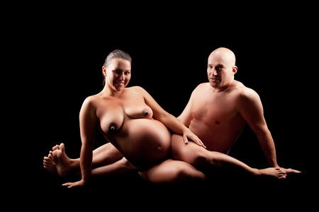 naked pregnant woman with her husband photo