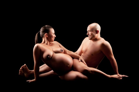 naked pregnant woman with her husband Stock Photo - 10751418
