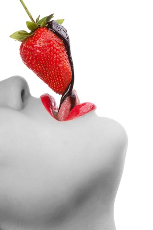 girl eating strawberry with chocolate sauc Stock Photo