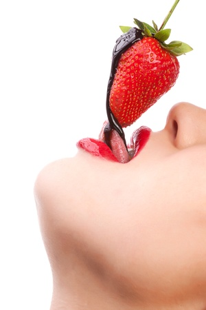 sexy lips: girl eating strawberry with chocolate sauc Stock Photo