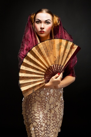 Beautiful young geisha girl photo