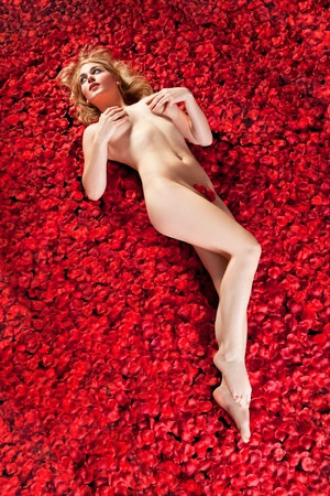 woman on a bed of rose petals Stock Photo