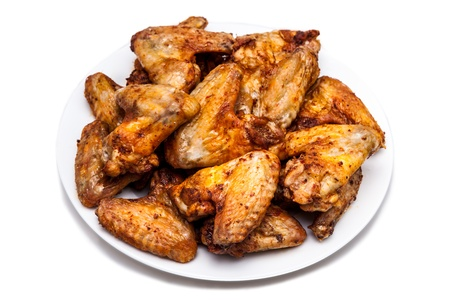 baked chicken: Plate of delicious barbecue chicken wings, on white