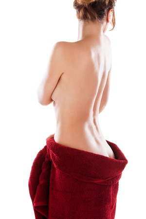 Young nude woman with red towel, isolated on white photo