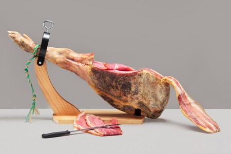 Spanish ham. Jamon Serrano. At grey background photo