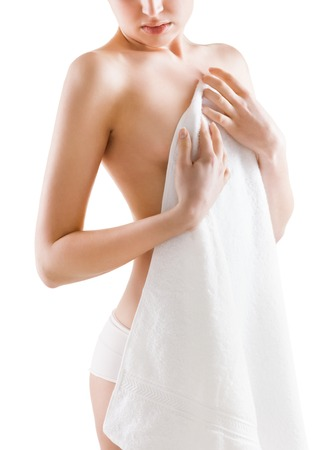 Young nude woman with towel, isolated on white photo