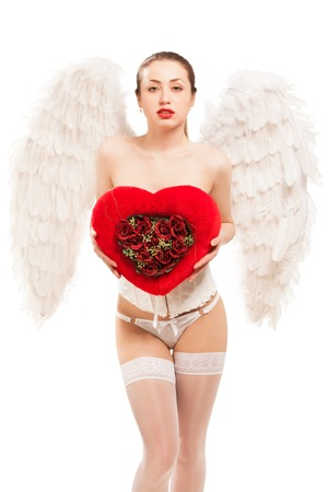 blond woman in angel costume holding heart