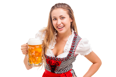 Beautiful bavarian girl with masskrug isolated over white background
