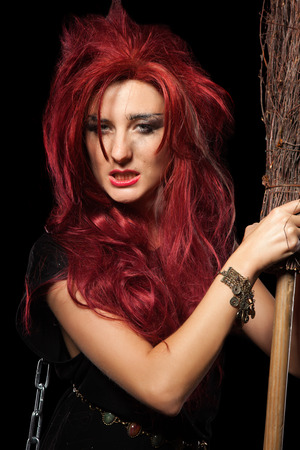redhaired: Charming red-haired witch with broom.