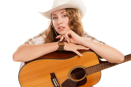 country western: Sesy cowgirl in cowboy hat with acoustic guitar