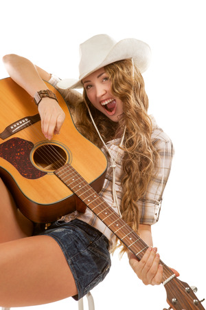 cowgirl hat: Sesy cowgirl in cowboy hat with acoustic guitar