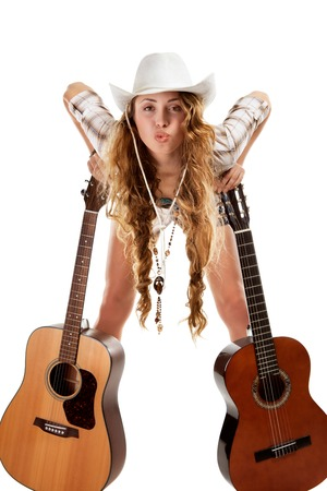 nylon string: Sesy cowgirl in cowboy hat with a nylon string acoustic guitar
