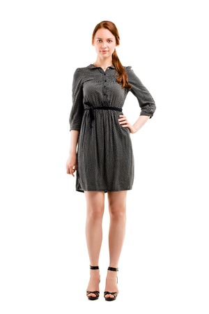 Full length portrait of a confident young female standing on white background Stock Photo