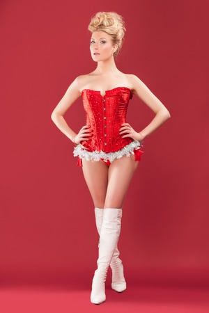 sexy christmas elf: beautiful blonde sexy girl wearing santa claus clothes Stock Photo