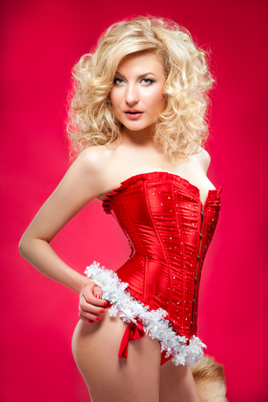 sexy elf: beautiful blonde sexy cheerful santa helper girl